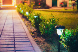freshly cut lawn with pathway lighting