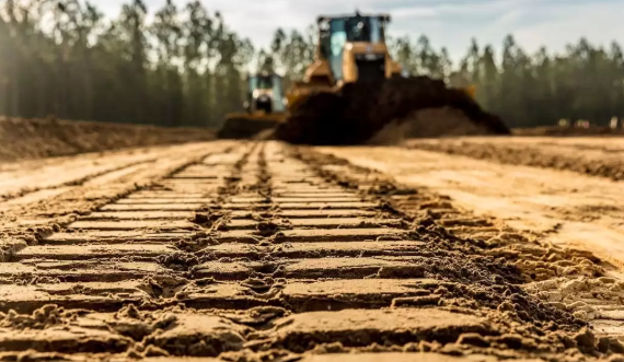 stripping off topsoil with dozers