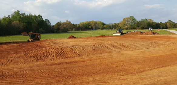 stripping top soil with skid steer and dozer